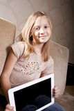 Smiling girl with tablet computer Stock Images