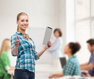 Smiling girl with tablet pc computer at classroom Stock Photo