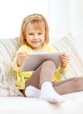 Smiling girl with tablet pc computer at home Royalty Free Stock Photo