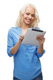 Smiling girl with tablet pc computer Stock Images