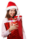 The  smiling girl  take the bag in red hat Stock Image