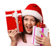 The  smiling girl  take presents Royalty Free Stock Image