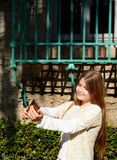 Smiling girl is taking photo with her cellphone. Stock Photo