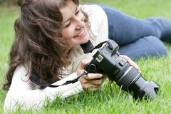 Smiling girl taking picture outdoors Stock Photo
