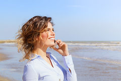 Smiling girl talking on the mobile phone Stock Photography