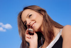Smiling girl talking on phone outdoors Stock Photos