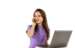 Smiling girl talking by phone Royalty Free Stock Images