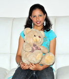 Smiling girl with teddy bear Stock Image