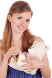 Smiling girl with teddy bear in hands Royalty Free Stock Image