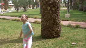 Smiling girl teenager dancing on background palm tree in summer park. Happy girl dancing and enjoying summer vacation. Summer activity concept stock video