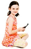 Smiling girl text messaging Royalty Free Stock Photography