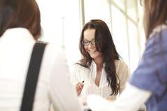 Smiling girl thinking Stock Photography