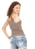 Smiling girl with thumb up Stock Images