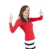 Smiling girl with thumbs up Royalty Free Stock Photos