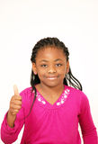 Smiling girl thumbs up sign. Smiling young girl making thumbs up sign, vertical portrait with copy space Stock Image