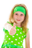 Smiling girl with thumbs up sign Royalty Free Stock Photo