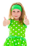 Smiling girl with thumbs up sign Royalty Free Stock Photography