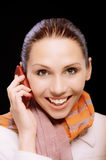 Smiling girl to call by phone Stock Image