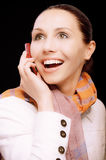 Smiling girl to call by phone Stock Photography