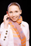 Smiling girl to call by phone Royalty Free Stock Photos