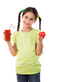 Smiling girl with tomato and glass of juice Royalty Free Stock Images