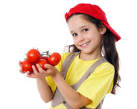 Smiling girl with tomatoes Royalty Free Stock Photos