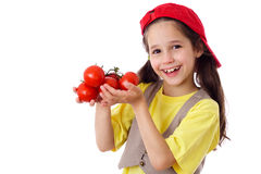 Smiling girl with tomatoes Stock Photos