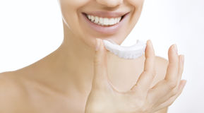 Smiling girl with tooth tray. Beautiful smiling girl with tooth tray (hands holding individual tooth tray Stock Photos