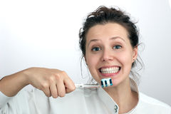 Smiling girl with a  toothbrush Stock Photo