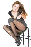 Smiling girl in the torn stockings stock image
