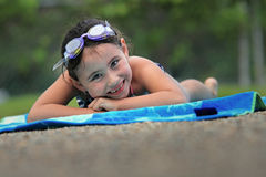 Smiling girl on a towel Stock Image