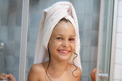 A smiling girl with a towel on his head Stock Photos