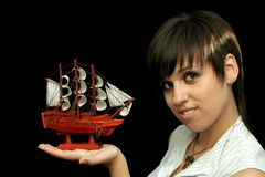 Smiling girl with the toy ship Stock Image