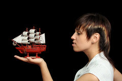 Smiling girl with the toy ship Stock Photo