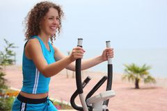 Smiling girl on training apparatus Royalty Free Stock Images