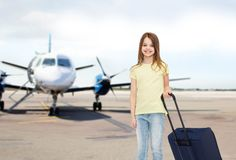 Smiling girl with travel bag in airport Royalty Free Stock Photography