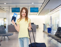 Smiling girl with travel bag ticket and passport Royalty Free Stock Image