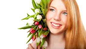 Smiling girl with tulips bouquet on white backgrou Royalty Free Stock Photography
