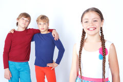 Smiling girl with two boys Stock Image