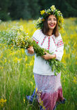 Smiling girl in Ukrainian costume with a wreath on his head in a Royalty Free Stock Photos