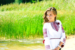 Smiling girl in the Ukrainian national clothes embroidery Royalty Free Stock Image