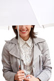 Smiling girl and umbrella. Smilling girl in grey coat under white umbrella Stock Photo