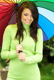 Smiling Girl with umbrella Stock Photo