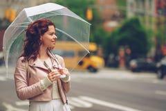 Smiling girl with an umbrella Royalty Free Stock Photos