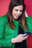 Smiling girl use smartphone outdoor portrait Royalty Free Stock Images