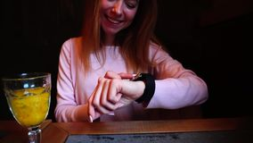 Smiling girl uses new smart watch on hand. stock video