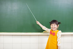 Smiling girl using a baton to point Royalty Free Stock Image