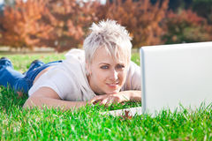 Smiling girl using laptop Royalty Free Stock Image