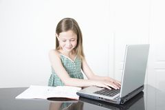 Smiling Girl Using Laptop Stock Photo