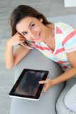Smiling girl using tablet Stock Images